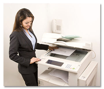 Woman Making Copies on Copy Machine